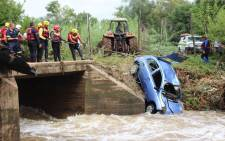 Recovery efforts came to a disappointing end as a Nissan Micra was pulled from the Apies River north of Pretoria. The car was swept away in a flash flood during heavy rains on Thursday. Picture: Christa Eybers/EWN.