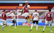 Aston Villa's English striker Keinan Davis (C) jumps for a header during the English Premier League football match between Aston Villa and Sheffield United at Villa Park in Birmingham, central England on June 17, 2020. The Premier League makes its eagerly anticipated return today after 100 days in lockdown but behind closed doors due to coronavirus restrictions. Picture: AFP.