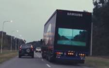 Samsung is working on a technology to let people see through giant trucks on the road.Picture: CNN/screen grab