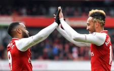 Arsenal's Pierre-Emerick Aubameyang and Alexandre Lacazette celebrate after a goal during a match against Stoke City on 1 April 2018. Picture: @Arsenal/Twitter.