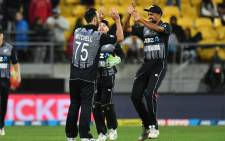 New Zealand's Ish Sodhi (R) with teammates Tim Seifert (C) and Daryl Mitchell (L) celebrate their win in the first Twenty20 cricket match between New Zealand and India in Wellington on 6 February 2019. Picture: AFP