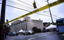 Police tape is viewed around the area on 28 October 2018 outside the Tree of Life Synagogue after a shooting there left 11 people dead in the Squirrel Hill neighbourhood of Pittsburgh on 27 October  2018. A man suspected of bursting into a Pittsburgh synagogue during a baby-naming ceremony and gunning down 11 people has been charged with murder, in the deadliest anti-Semitic attack in recent US history. The suspect - identified as a 46-year-old Robert Bowers - reportedly yelled 'All Jews must die' as he sprayed bullets into the Tree of Life synagogue during Sabbath services on Saturday before exchanging fire with police, in an attack that also wounded six people. Picture: AFP