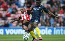 Sunderlands English striker Jermain Defoe (L) vies with Southamptons Kenyan midfielder Victor Wanyama during the English Premier League football match between Sunderland and Southampton at the Stadium of Light in Sunderland, northeast England, on 2 May, 2015. Picture: AFP.