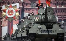 Soviet WWII-era T-34 tanks move through Red Square during a military parade, which marks the 75th anniversary of the Soviet victory over Nazi Germany in World War Two, in Moscow on 24 June 2020. Picture: AFP
