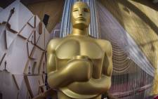 An Oscars statue is displayed on the red carpet area on the eve of the 92nd Oscars ceremony at the Dolby Theatre in Hollywood, California, on 8 February 2020. Picture: AFP.
