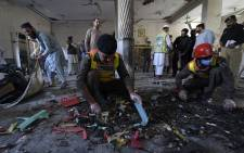 Security officials examine the site of a blast at a religious school in Peshawar on October 27, 2020. At least four students were killed and dozens more wounded on October 27 when a bomb exploded during a class at their religious school in Pakistan, officials said. Picture: AFP