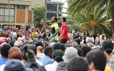Former Wits University SRC head Mcebo Dlamini addresses hundreds of students on the varsity's education campus on 21 October 2015 as students protested for another day over proposed tuition fee increases. Picture: Reinart Toerien/EWN.