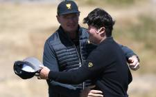 International Team captain Ernie Els of South Africa (L) celebrates with An Byeong-hun during day one of the Presidents Cup golf tournament in Melbourne on 12 December 2019. Picture: AFP