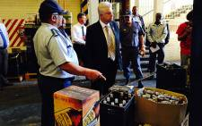 FILE: Western Cape police destroy alcohol which was confiscated at various illegal outlets. Picture: Rafiq Wagiet/EWN.