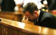 Paralympian Oscar Pistorius reacts as judgment is handed down at the High Court in Pretoria on Friday, 12 September 2014. Picture: Pool.