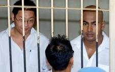 "In this file photograph taken on February 14, 2006, Australian drug traffickers Andrew Chan (L) and Myuran Sukumaran (R) the ringleaders of the ""Bali Nine"" drug ring, look on from a holding cell while awaiting a court trial in Denpasar on Bali island. Picture: AFP"