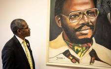 Velenkosini Hlabisa looks on at Buthelezi's portrait at the IFP's offices in Ulundi, KwaZulu-Natal. Picture: Xanderleigh Dookey/EWN