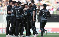New Zealand's players celebrate the wicket of Pakistan's Mohammad Rizwan during the first T20 international cricket match between New Zealand and Pakistan at Eden Park in Auckland on December 18, 2020. Picture: AFP