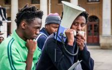 UCT SRC candidates Mlingani Matirane and Sihawo Thambo speak to a gathering of UCT Fees2017 protesters at upper campus. Picture: Anthony Molyneaux/EWN.
