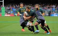 Frans Steyn takes on two World XV players as Duane Vermeulen and Morne Steyn look on.