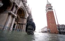 "A man walks in flooded St. Mark square in Venice, during ""acqua alta"", or high water, of 160 centimetres on 17 November 2019. Picture: AFP"