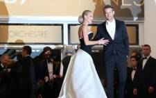 FILE: Canadian actor Ryan Reynolds and his wife US actress Blake Lively pose as they arrive for the screening of the film Captives. Picture: AFP.