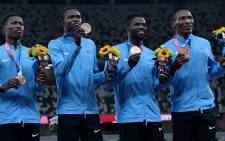 Botswana's bronze medallists (from left)  Bayapo Ndori, Zibane Ngozi, Baboloki Thebe and Isaac Makwala pose during the victory ceremony for the men's 4x400m relay event at the Tokyo 2020 Olympic Games at the Olympic Stadium in Tokyo on 7 August 2021. Picture: Javier Soriano/AFP