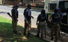 FILE: Police stand guard outside the Democratic Republic of Congo embassy in Pretoria during protests calling on DRC President Joseph Kabila to step down. Picture: Pelane Phakgadi/EWN.