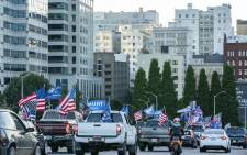 FILE: Pro-Trump supporters drive into downtown during a rally in support of the president on 29 August 2020 in Portland, Oregon. Far left counter-protesters and pro-Trump supporters clashed Saturday afternoon as a parade of cars carrying right wing supporters made their way from nearby Clackamas to Portland. Picture: AFP.