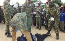 At least 48 people were killed when suspected al-Shabaab militants from Somalia stormed into a Kenyan coastal town and launched a major assault on a police station, hotels and government offices on 16 June. Picture: AFP.