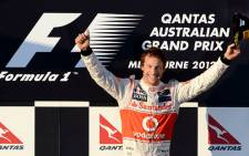 McLaren-Mercedes driver Jensen Button of Britain celebrates winning Formula One's Australian Grand Prix in Melbourne on March 18, 2012. Button led throughout the opening race of the 2012 Formula One Grand Prix season on the 5.3km Albert Park road circuit. Picture: AFP.