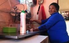 Amelia Thruben shows an empty tap at her home. Picture: Kaylynn Palm/EWN