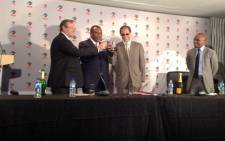 The PSL chairperson Irvin Khoza toasts to the announcement of the new PSL gaming rights deal. Picture: Marc Lewis/EWN.