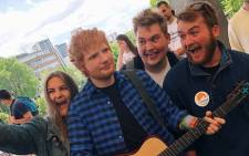 FILE: Fans gather around a wax figure of British musician Ed Sheeran at Madame Tussauds in London. Picture: @MadameTussauds/Twitter