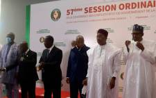 From (L-R): Presidents of Burkina Faso Roch Marc Christian Kaboré, President of Ghana Nana Akufo-Addo, President of Ivory Coast leader Alassane Ouattara, ECOWAS Commissioner Jean-Claude Kassi Brou, President of Niger Mahamadou Issoufou, and President of Nigeria Muhammadu Buhari of Nigeria pose for a group photo during an Economic Community of West African States (ECOWAS) leaders summit in Niamey on 7 September 2020. Picture: AFP