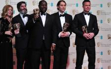 US producer Dede Gardner, US producer Jeremy Kleiner, British director Steve McQueen, producer Anthony Katagas and US actor Brad Pitt pose with their awards for best film for '12 Years A Slave' at the BAFTA British Academy Film Awards. Picture:AFP.