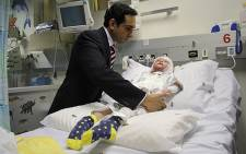 "Dr Ridwan Mia attends to Isabella ""Pippie"" Kruger on 4 July 2012. Picture: Taurai Maduna/EWN"