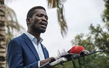 Musician-turned-politician Robert Kyagulanyi, also known as Bobi Wine, speaks during a press conference at his home in Magere, Uganda, on 15 January 2021. Picture: Sumy Sadruni/AFP
