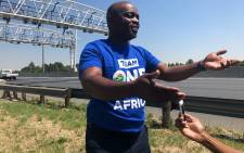 DA Gauteng premier candidate Solly Msimanga standing next to the N12 where he will be briefing the media about. Picture: Mia Lindeque/EWN
