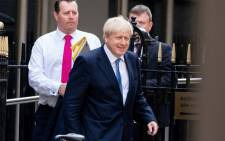 FILE: New Conservative Party leader and Prime Minister Boris Johnson leaves the Conservative party headquarters in central London on 23 July, 2019. Picture: AFP.