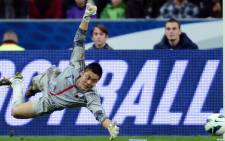 Japan's goalkeeper Eiji Kawashima jumps to catch the ball during the friendly football match France vs Japan, on 12 October, 2012 at the Stade de France in Saint-Denis, near Paris. Picture: AFP