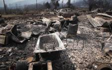 The shells of burnt out cars and appliances are all that's left of the homes of South African National Parks workers. Picture: Bertram Malgas