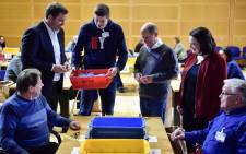 Secretary-General of the Social Democratic Party (SPD) Lars Klingbeil (2nd L) and Social Minister Andrea Nahles (2nd R) react as a volunteer (3rd L) brings the ballots to be counted at the headquarters of Germany's social democratic SPD party in Berlin on 3 March, 2018, as SPD members voted on whether or not to join a new coalition government with German Chancellor Angela Merkel's conservatives. Picture: AFP.