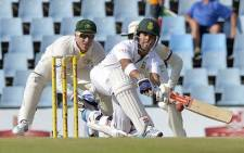 South African cricketer JP Duminy plays a shot during the second day of the first test match between South Africa and Australia at SuperSport Park in Centurion on February 13, 2014. Picture: AFP.