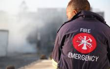 FILE: A firefighter watches after a blaze is extinguished. Picture: EWN