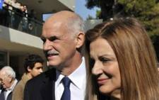 Greek Prime Minister George Papandreou and his wife Ada (R) leave a polling station in Athens on November 7, 2010. Picture: AFP.