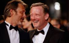 Danish actor Mads Mikkelsen (L) and British actor Douglas Henshall laugh as they arrive for the screening of the film The Salvation at the 67th edition of the Cannes Film Festival in Cannes, southern France on 17 May 2014. Picture: AFP/ VALERY HACHE