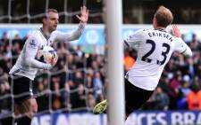 Tottenham Hotspur's Danish midfielder Christian Eriksen (R) celebrates after scoring his team's first goal during the English Premier League football match between Tottenham Hotspur and Southampton at White Hart Lane in north London on 23 March 2014. Picture: AFP.