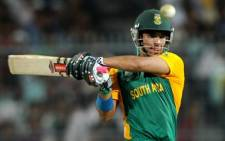 South African batsman JP Duminy keeps his eyes on the ball after playing a shot during the Group B Match against Ireland on 15 March 2011. AFP