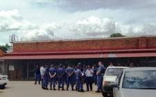 Police gather to plan their strategy against violet protesters in Zithobeni outside Bronkhorstspruit. Picture: Masego Rahlaga/EWN.