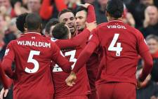 Liverpool defender Dejan Lovren (C) celebrates with teammates after scoring the opening goal of the English Premier League football match against Newcastle United at Anfield in Liverpool, north-west England on 26 December 2018. Picture: AFP