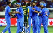 India's players celebrate their victory during the Pool B 2015 Cricket World Cup match between South Africa and India at the Melbourne Cricket Ground (MCG) on 22 February, 2015. Picture: AFP.