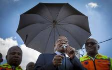 President Jacob Zuma, Gauteng Premier David Makhura (R) and Min of Cooperative Governance Des van Rooyen address resident of Setjwetla, an the area of Alexandra that was flooded.  Picture: Thomas Holder/EWN