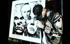 Artwork by Chris Brown and photographer Karen Bystedt inspired by legendary US artist Andy Warhol has been put up on online auction site eBay with a starting bid of $500,000. It's called the Triple Andy Discount. Picture: eBay.
