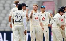 England's Ben Stokes (C) celebrates with teammates after taking the wicket of Pakistan's Shaheen Afridi on the third day of the first Test cricket match between England and Pakistan at Old Trafford in Manchester, north-west England on 7 August 2020. Picture: AFP